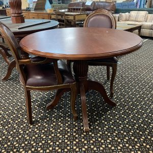 ornate round dining table